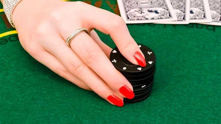 Woman's hand on casino chips